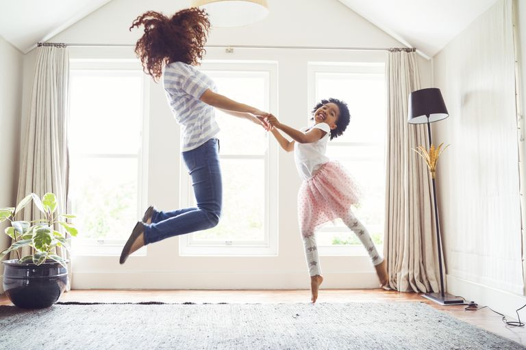 Mother and daughter jumping while doing ballet
