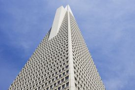 detail of skyscraper exterior, tapering toward the top with a concrete-colored wing