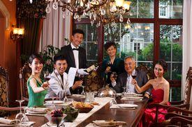 Tasteful setting with tasty wine and food.