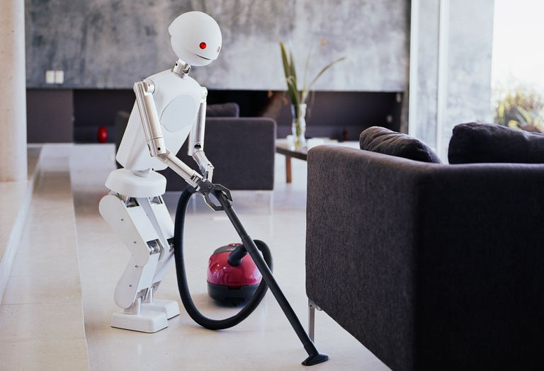 a robot vacuuming a living room