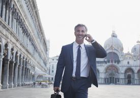 Italian businessman talking on cellphone in Venice