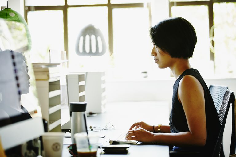 Businesswoman working on project on computer