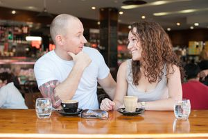 Couple talking at cafe