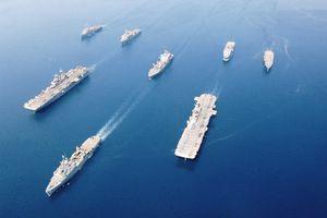 Fleet of military ships at sea in Arabian Gulf, May 2003.