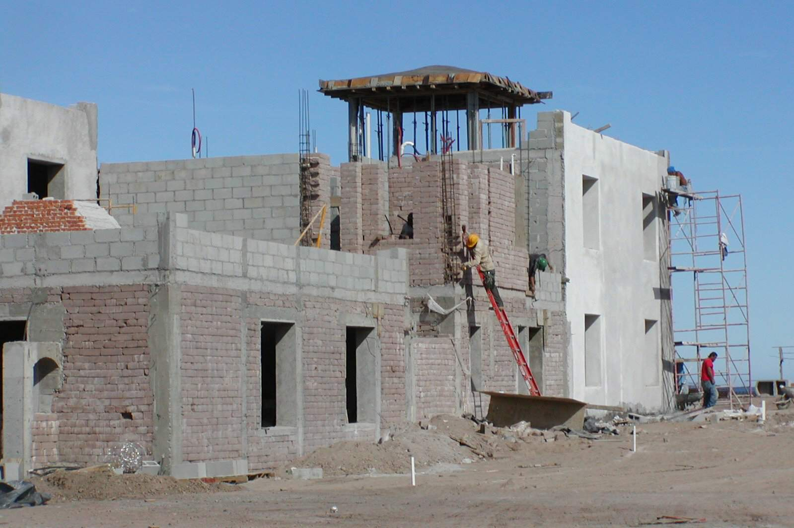 Construction of residence using earth blocks and cement blocks