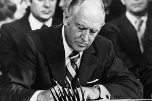 Rogers Signs Paris Peace Accords