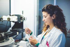 Female scientist preparing an x-ray diffractometer