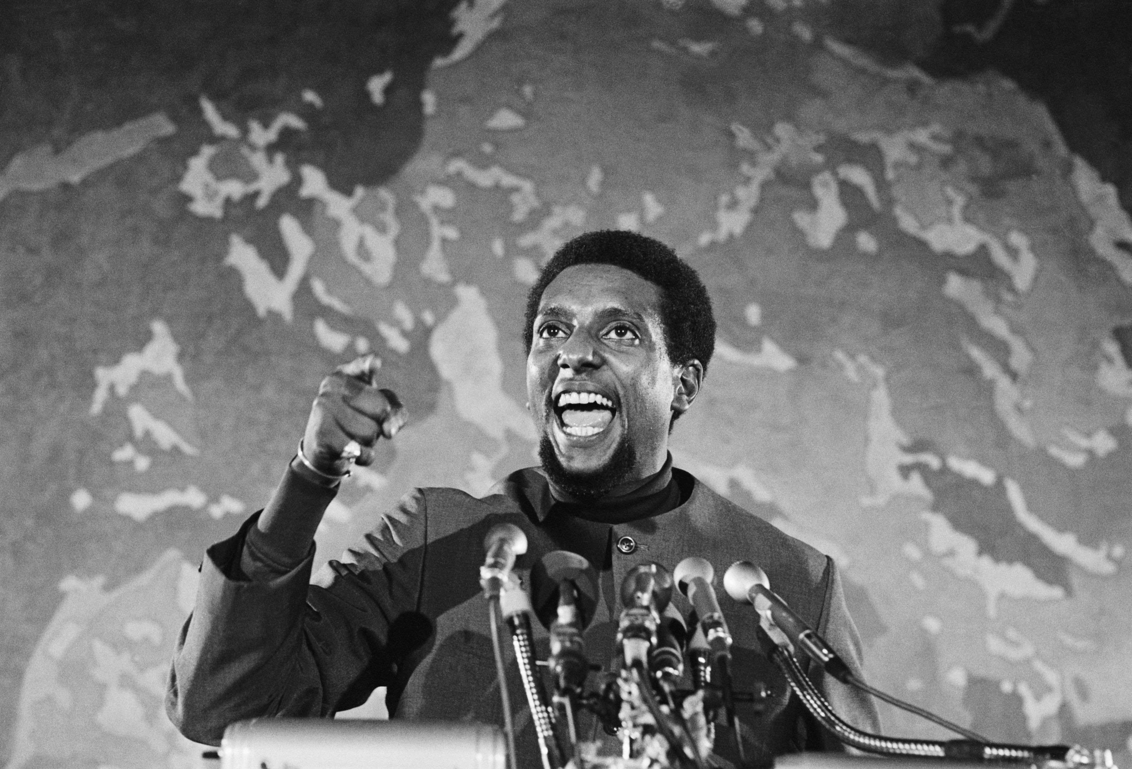 Stokely Carmichael Speaking at podium during Civil Rights Rally