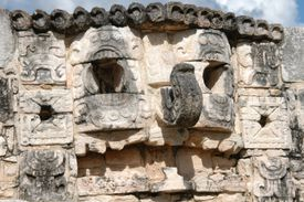 Close up of Mayan God, Chaac's face on side of building.