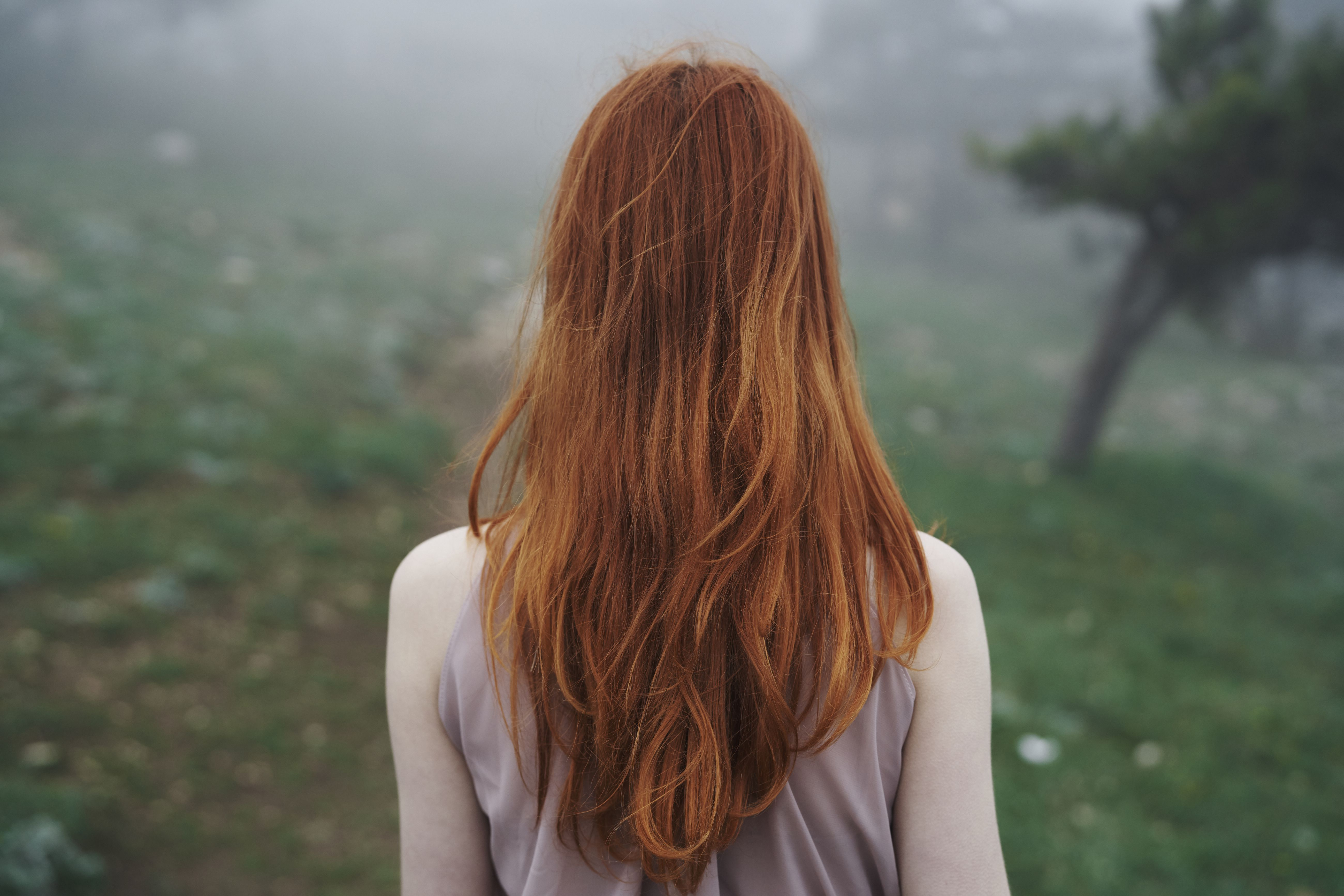 Rear view of Caucasian woman with red hair