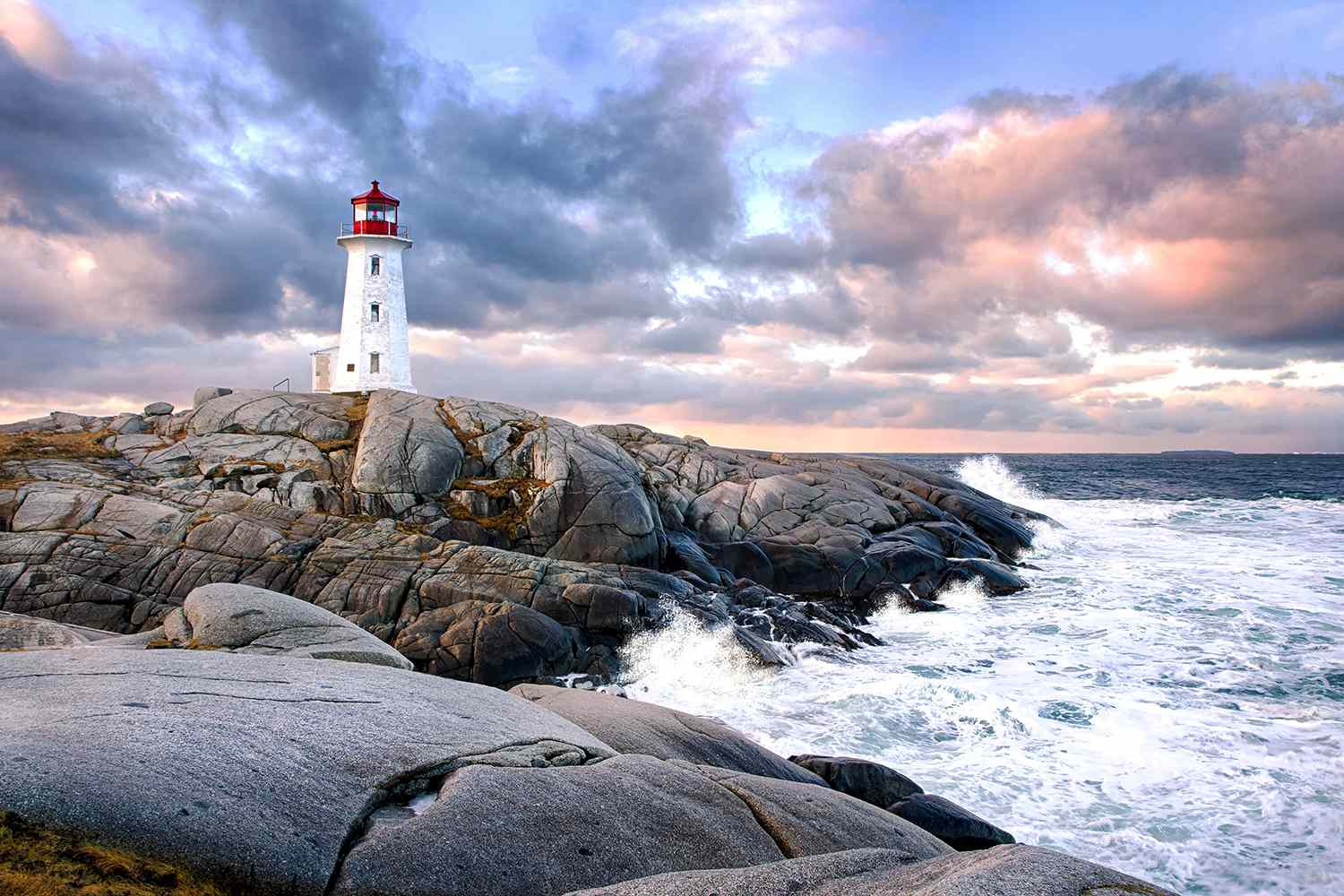 Peggy's Cove Lighthouse at sunset in Halifax