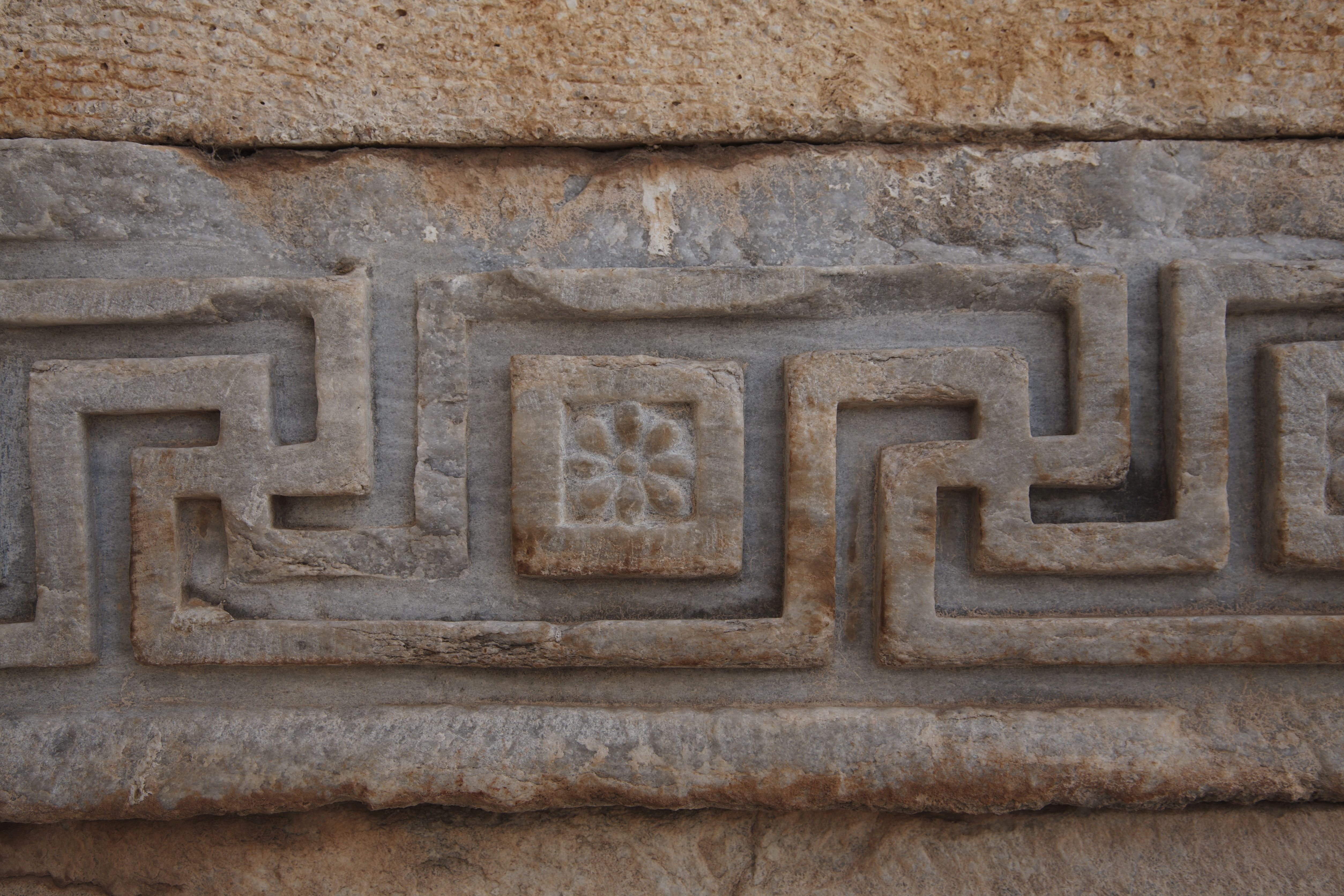 Carved swastika patterns in The Temple of Hadrian, Turkey.