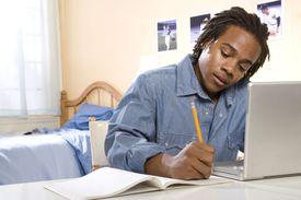 student writing essay