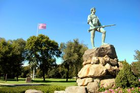 The famous statue of the Revolutionary War minuteman stands tall on Lexington Green. It is here the Revolutionary War started in 1775.