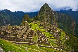 Machu Pichu ruins on a cloudy day.