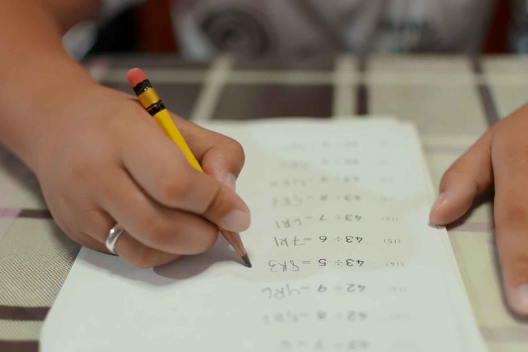 A student doing a math assignment.