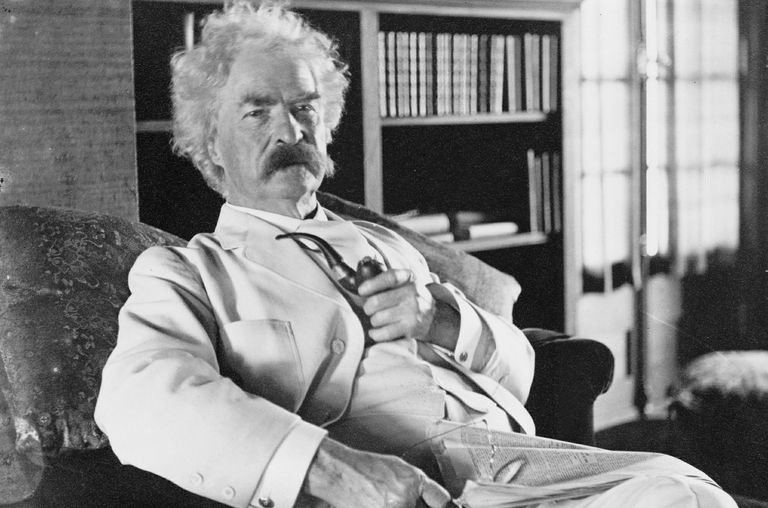 A historical photo of Mark Twain with a tobacco pipe