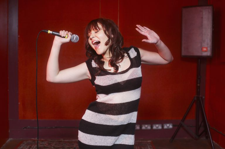 A woman singing at an open mic