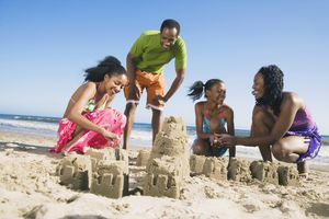 African family building sand castles
