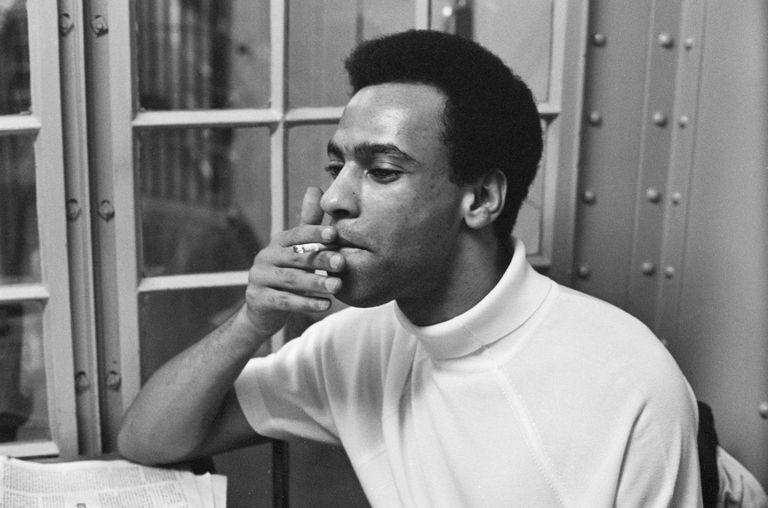 photo of Huey Newton in a holding cell
