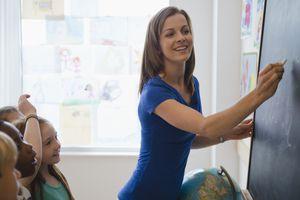 teacher at chalkboard with children