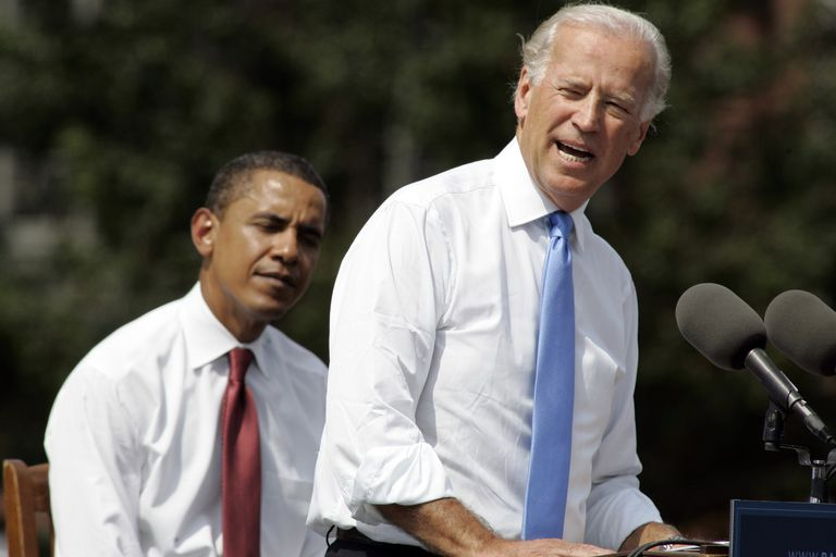 Sen. Joe Biden delivers a speech as Sen. Barack Obama listens. (Photo by Frank Polich/Getty Images)
