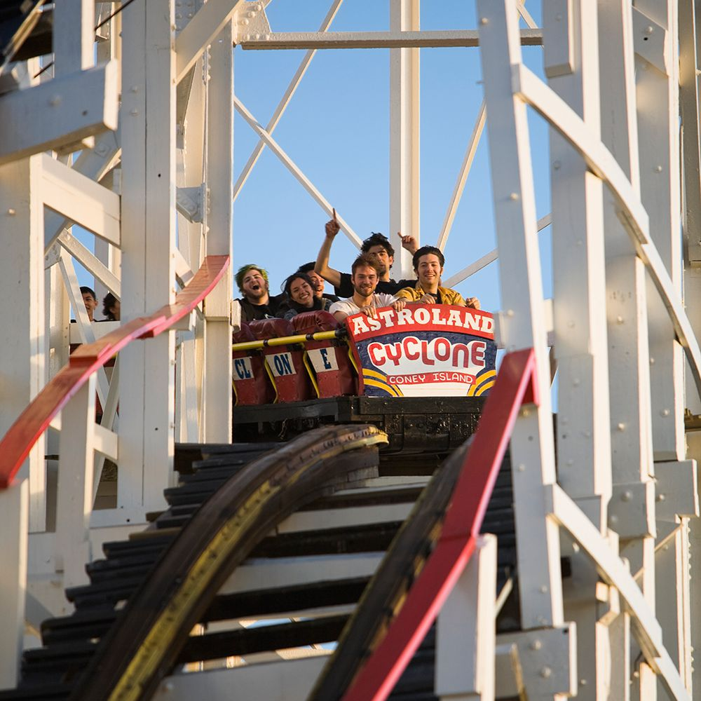 People Riding the Cyclone at Coney Island during daytime.