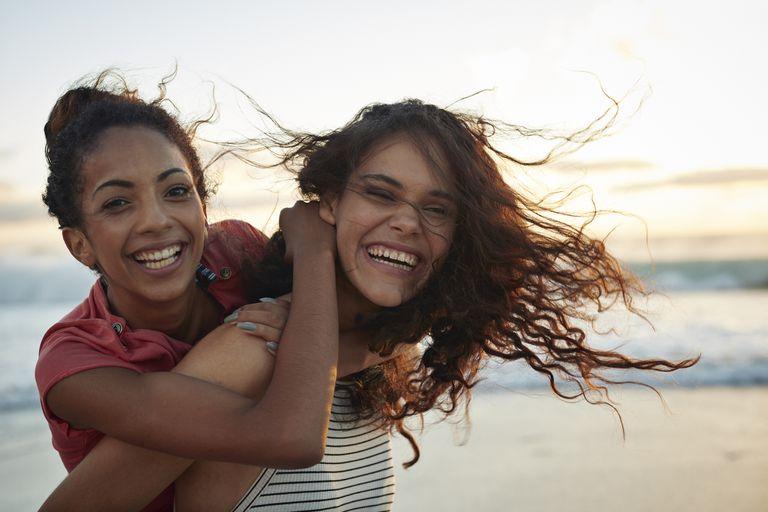 Two women looking happy