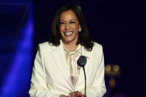 Kamala Harris stands at a podium with a microphone