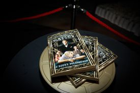 Several copies of F. Scott Fitzgerald's 'The Great Gatsby,' featuring characters from a film adaptation on the book's cover.