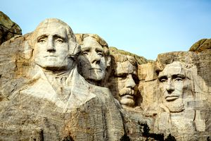 Mount Rushmore features 60-foot-tall sculptures of the faces of George Washington, Thomas Jefferson, Teddy Roosevelt, and Abe Lincoln