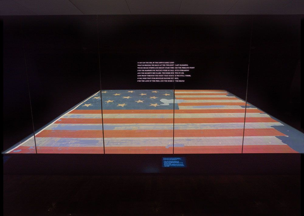 The Fort McHenry Flag on display at the Smithsonian.