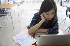 Middle school girl doing algebra
