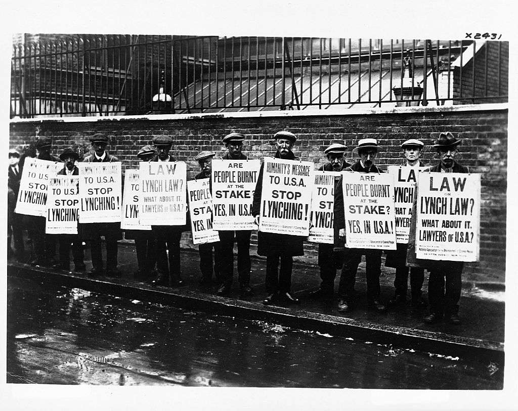 people protesting lynch laws and Jim Crow