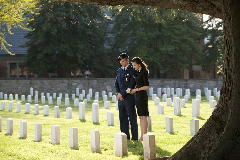 Soldier and wife visiting cemetery together