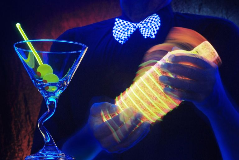 Bartending making glowing drinks