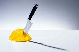 A knife stuck in yellow Jell-O