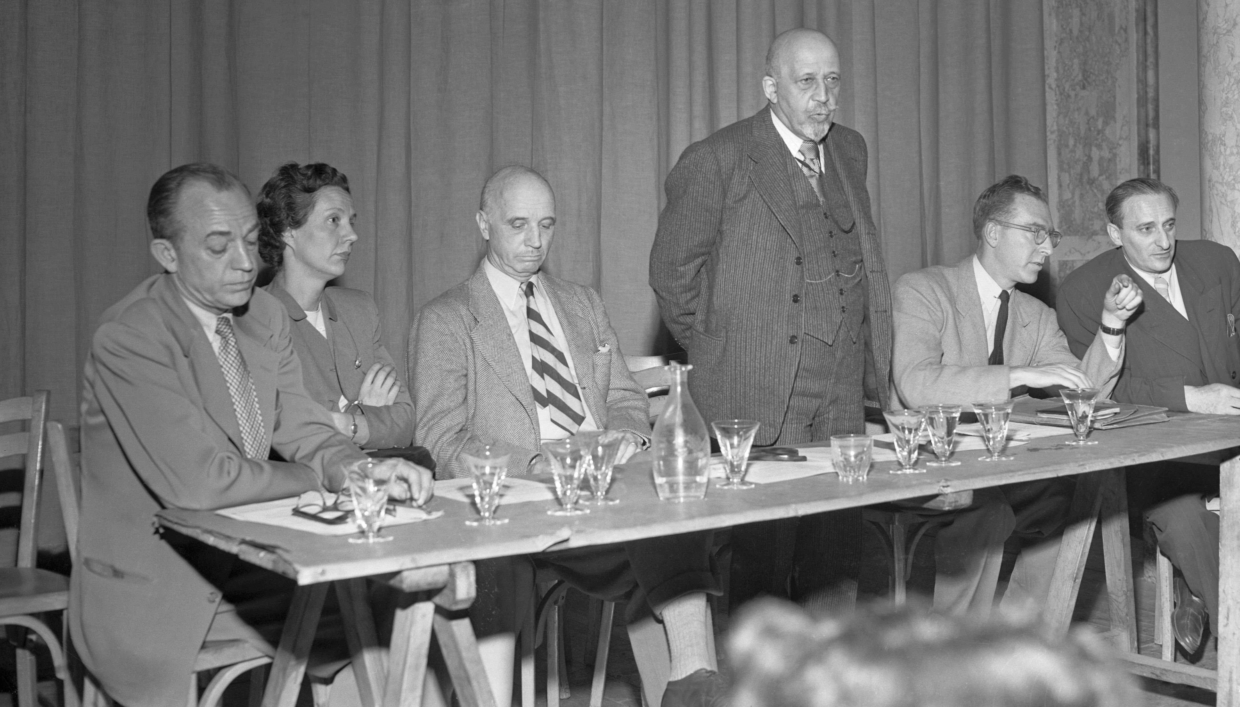W.E.B. Dubois Standing at Table