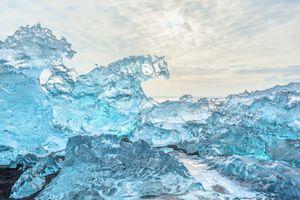 Ice rock with black sand beach at Jokulsarlon beach (Diamond beach) in southeast Iceland.