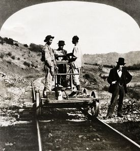 Chinese immigrants working on the railroad tracks