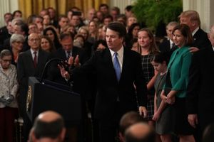 U.S. Supreme Court Justice Brett Kavanaugh (C) takes the podium as his wife Ashley (2nd R), daughters Liza (4th R) and Margaret (3rd R), and President Donald Trump (R) look on during a ceremonial swearing in
