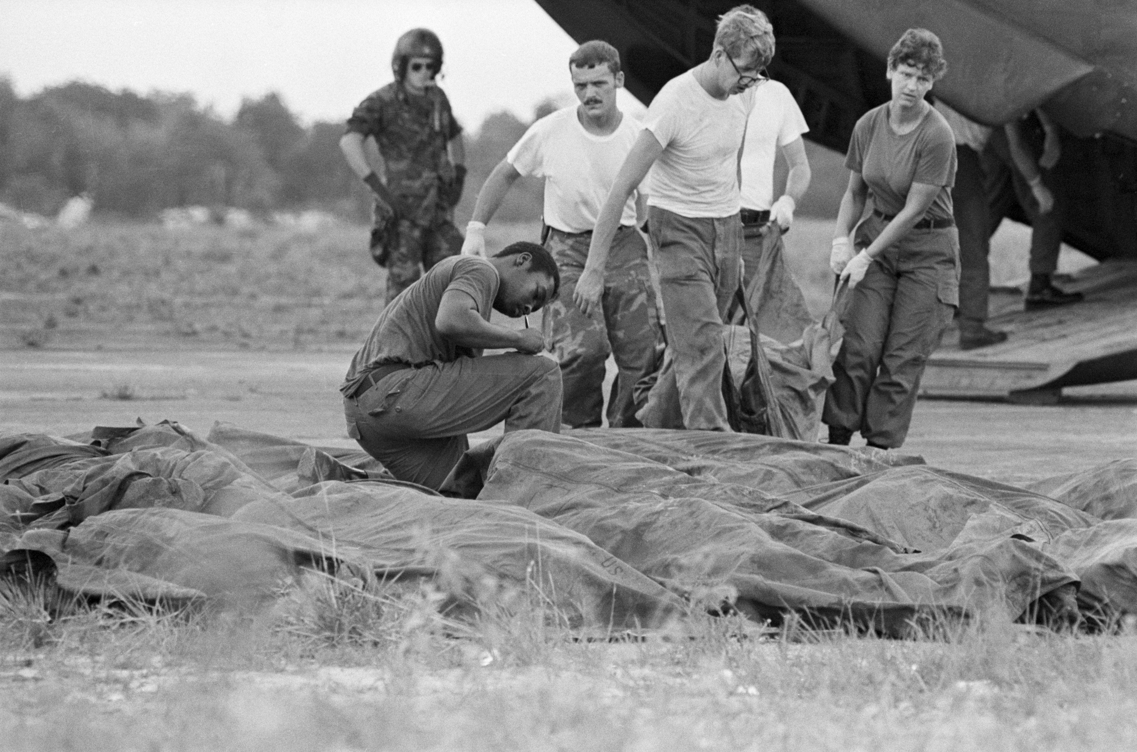 People Removing Bodies of Jonestown Suicide