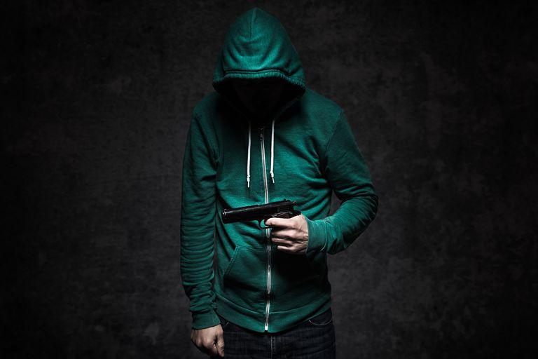 Hoodied teen holding gun