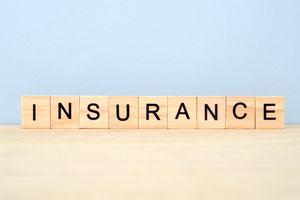 Insurance Word on Wooden Tile Block