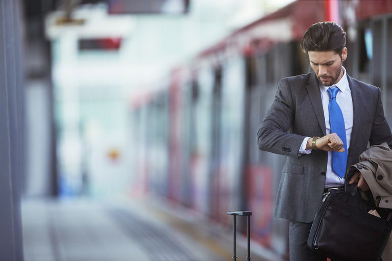 Businessman checking his watch in train station