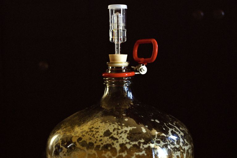 The top of a fermentation flask filled with beer