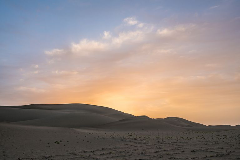The Taklimakan Desert of Xinjiang at sunset.