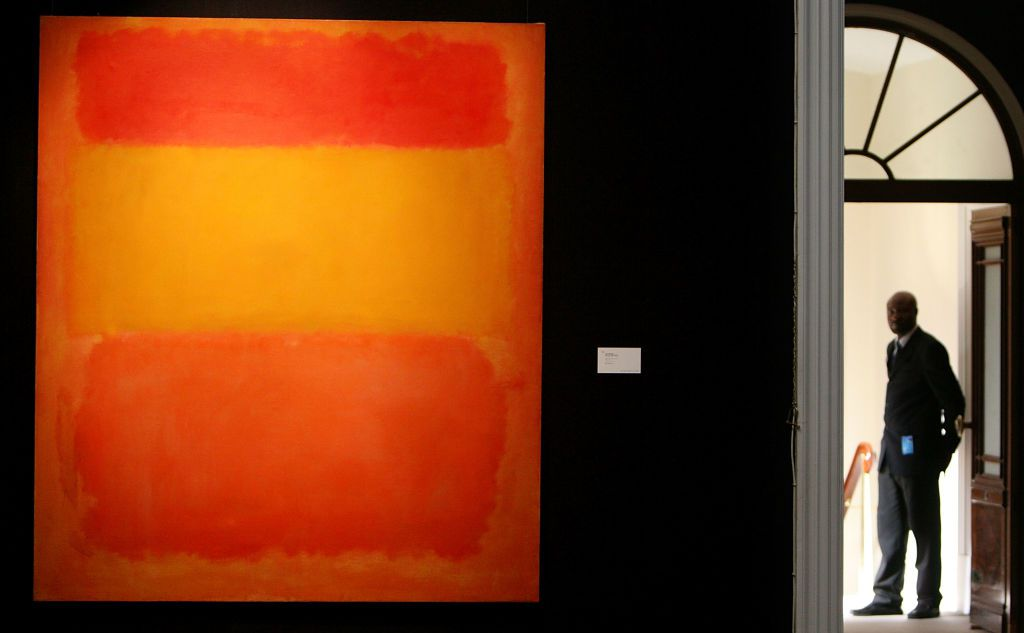 A guard standing next to Mark Rothko's Orange, Red, Yellow