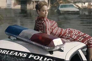 Beyonce sits atop a sinking New Orleans Police car in the Formation video