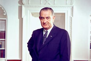 Photo portrait of LBJ standing in the Oval Office.